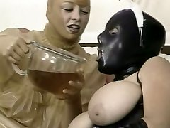 Two kinky chicks in latex outfit munch each other snatches in 69 style