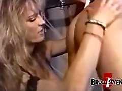 Buxom dyke dominatrix penalizes sub after playing with her
