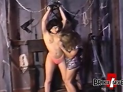 Lesbo femdom playing with her restrained submissive