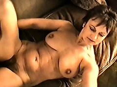 Yvonne's big knockers hard nipples and wooly pussy