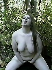 Playing by herself in the woods