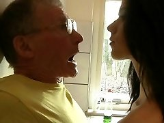 Daring young brunette fucks rigid grandpa in the kitchen