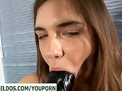Teen with a huge dark-hued aggressive dildo