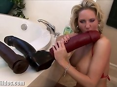 Huge-chested milf squirting from a huge faux-cock