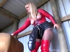 Dom displaying off her giant dildos to sissy
