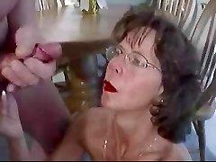 Mature brunette in glasses cherishes huge facial cumshot.