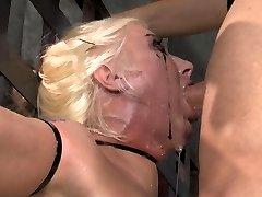Spit adorned face from BDSM face pummel