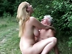 Natural meaty titted slut fucks grandpa in the woods