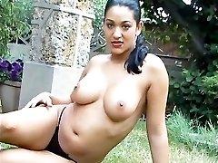 Busty Latina teasing under the sun