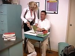 Mature blond with enormous bosoms drilled by student in the classroom