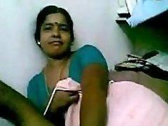 Indian Mature Dark-hued Maid taunting her master