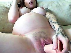 Pregnant brunette slutty milks with huge dildo