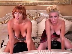 Two girls railing two fuck machine on a couch