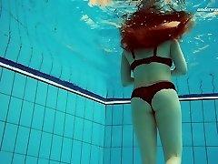 Beautiful Vesta disrobing underwater in arousing solo movie