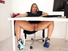 Chubby English nymphomaniac Ashley Rider touches her meaty pussy in the office