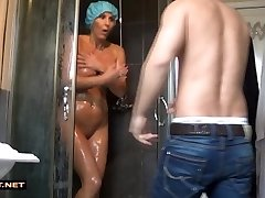 Real stepson rescuses step-mother from the douche