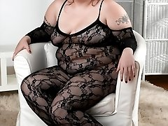 Cierra is wearing her fishnet lingerie and nothing else! The red head fatty feels very sexy and is always waiting for her chance to rub her juicy pussy while she fucks herself with her thick dildo!