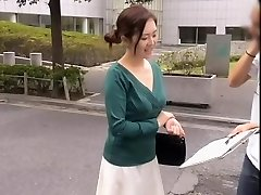Friendly Asian nymph keeps sneering while her cleavage is totally revealed