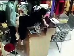 Boss has hump with employee behind money register in China