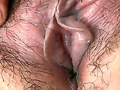 Japanese Grandma displays Tits and Pussy