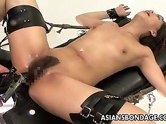 Bound Asian handles sex machines like a trooper