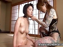Tatted up Asian domina strap on fucking the sub