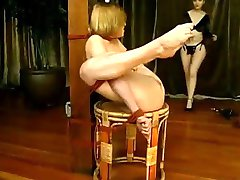 Bound lesbian sub toyed with