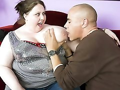 Bbw Jelli Bean flaunts her huge knockers and lets a naughty guy admire it by nibbling at her puffies
