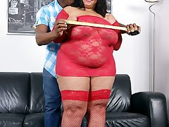 Big-racked ebony fattie in sizzling hot crimson nylon enjoys some raw fucking