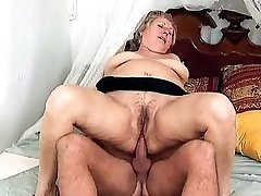 Slutty mature plumper enjoying a ample manmeat up her twat