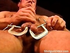 Built bear punishes his own balls with clamps. a mallet and his own hands.