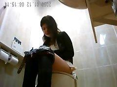 Asiatic women spied in public toilet peeing