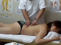 Medical voyeur massage video starring a plump Asian dressed in black panties