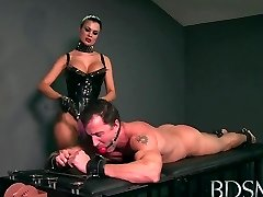 Sexy Mistress loves teasing her marionette boys rock-hard cock while he's handcuffed