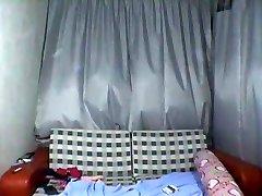 Aziatische tiener, strippen voor de webcam