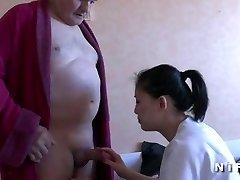 Youthful nurse blows an old man