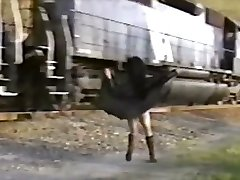 Japanese girl in trench coat flashes train