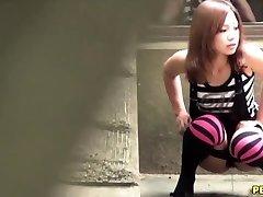 Chinese slut pee squats