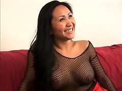 Guy gets a sole job from a uber-cute asian in fishnets