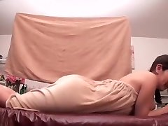 Lubed Asian darling chooses getting massaged by her friend