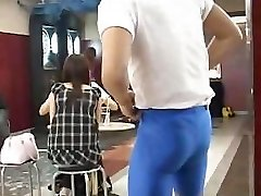 Muscular guy flashes very cute busty Asian female in a bar