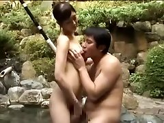 Breasty fuckslut porking an Asian guy in a pool