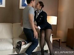 Steaming stewardess is an Asian doll in high high-heeled shoes