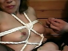 Sexy Asian pussy pleasures while frog-tied