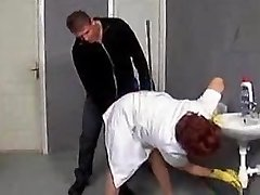 Mature cleaner enticed on the rest room floor