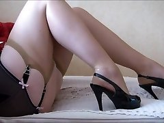 Mature Legs And High High-heeled Shoes