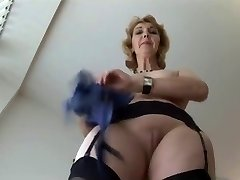 Mature English blonde babe in stocking upskirt tease