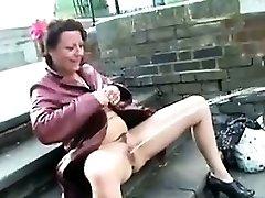 Mature British Gal Pissing In Public