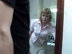 Mature mummy takes a urinate on the toilet and gets interrupted by her son-in-law for a nail