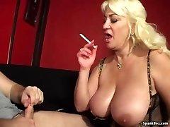 Busty mom gives deep throat and smokes ciggy